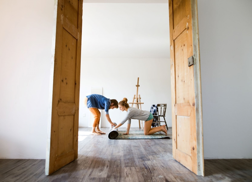 Canva - Young Couple Moving in New House